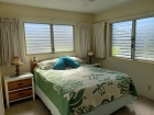 Bedroom with queen size bed and extra windows