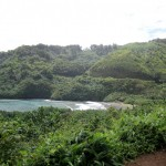 Black sand beach and cove on the road to Hana